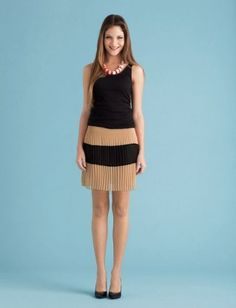 Wear it at night. Make your tea-length skirt a mini: Fold in the top half, and let an untucked tank graze the waistband.