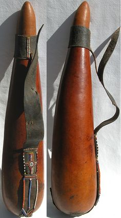 Africa   Long and beautifully shaped milk container from the Massai people   It is made from a gourd and has leather straps decorated with beads and a button.