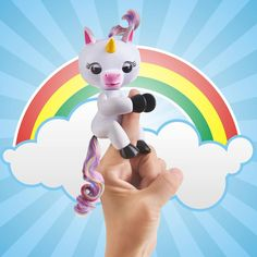 How cute is Gigi the Unicorn! With her beautiful rainbow tail she is the ultimate fun. She can't wait to play with her new Finger Monkey friends. Get her at retrobonus.com  #Fingerlings #Unicorn #Magical #Toys #Fun #Cute #MomLife #Kids #Christmas #Awesome