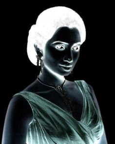 Stare at the woman's nose for about 10 seconds. Then look at a lighter surface, like a wall, and blink rapidly. Her face should now have color!