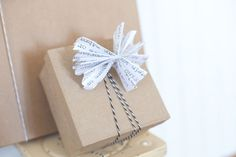 DIY Basics: Accordion Bow Gift Toppers via Brit + Co.