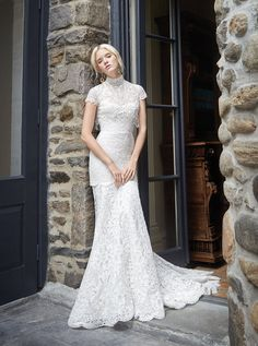 Style 9606 - Ivory / Blush re-embroidered lace fit n flare bridal gown with shimmer throughout. Strapless sweetheart neckline with a sheer back bodice. Shown with a sheer beaded and embroidered high neck jeweled fringed jacket. Beaded jacket sold separately.