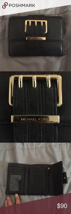 Michael kors black wallet Michael kors black leather wallet with gold accents. Opens to three pockets. Plenty of spots for cards, cash, and zipper pocket for coins. Botton to snap close. Michael Kors Bags Wallets