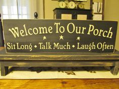 Primitive Wood Sign, Welcome To Our Porch, Sit Long, Talk Much, Laugh Often. $21.00, via Etsy.