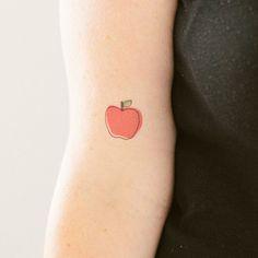 Red pretty apple tattoo