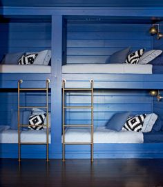Adding built-in bunks (clad in V-groove pine to match the existing walls) turned unused space into a welcoming room. Navy paint adds to the cozy vibe. would so do a nautical theme in this room Bunk Beds Built In, Kids Bunk Beds, Loft Spaces, Kid Spaces, Small Spaces, Bunk Rooms, Cabin Interiors, Dream Rooms, Living Room Designs