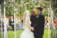 """The couple was surrounded by all their family and friends while they said their vows under this stunning """"gazebo"""""""
