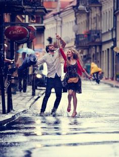Rainy day couple in street of London.