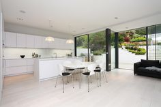 Kitchen trends 2016: All white kitchen in Polar White satin lacquer finish, with 20mm Designer White Corian worktops.