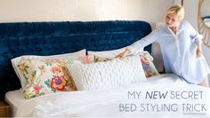 Bed styling trick- 2 flat pillows as a base. 2 fluffier pillows on top, and one long rectangular pillow to finish.