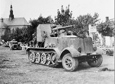 A Bussing-Nag  SdKfz 6 with a mounted 88mm FlaK 18 gun with armored cab