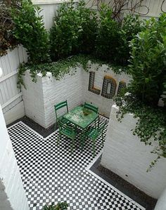 Outside space - black and white tiled floor < the poetry of material things (hva)