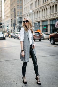 A WHITE BUTTON-DOWN SHIRT & LONG VEST