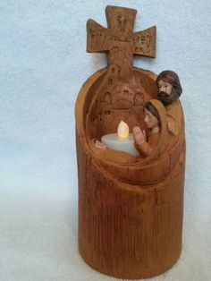 Wood carved nativity candle holder