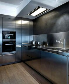 Superieur This Stainless Steel Kitchen Has Appliances, Faucet, Sink, Walls, Counter  Topsu2026