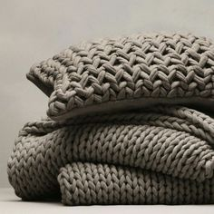 Buy Bedspreads & Cushions Collection > Bedspreads & Cushions Collection > Chunky Hand Knit Throw & Cushion Cover - Smoke from The White Company Knitted Pouf, Knitted Throws, Knit Crochet, Knitted Cushions, Knit Blankets, Yarn Projects, Knitting Projects, Tapetes Diy, Tricot Simple