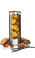 The Gingerbread is a refreshing orange Christmas drink made from Frangelico hazelnut liqueur, dark rum, cinnamon schnapps and ginger beer, and served over ice in a chocolate-rimmed highball glass.