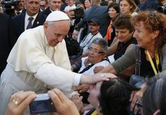 Pape François - Pope Francis - Papa Francesco - Papa Francisco - Pope Francis blesses a woman in a wheelchair during an encounter with youth in Cagliari, Sardinia, Sept. 22. (CNS photo/Paul Haring) (Sept. 23, 2013)