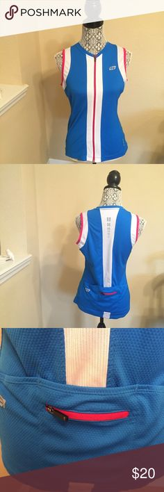 """Bellwether Cycling 🚴🏼♀️ Jersey Size L Size: L Color: Blue, Pink and White Design: Sleeveless Cycling Jersey Sleeves: Sleeveless Materials: 100% Micro Polyester / 95% Polyester 5% Spandex  Measurements (approximate) Length: 25"""" Underarm to underarm (laying flat): 18.5""""  Condition: Excellent pre-owned condition Bellwether Tops Tank Tops"""
