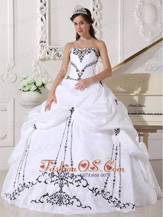 Lovely White Sweetheart Quinceanera Dress with Black Embroidery  http://www.fashionos.com  http://www.youtube.com/user/fashionoscom?feature=mhee   Taffeta gown with a strapless sweetheart neckline,fitted bodice with symmetrical embroidery trimed give this dress strong visual impact.The top skirt with pick ups and scattered wonderful embroidery accents the whole skirt give you an ultra-sophisticated look.