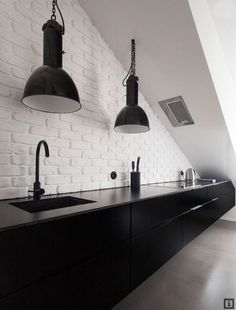 White brick texture as contrast in an otherwise white kitchen