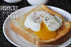 PERFECTLY POACHED EGGS — Take the guess work out of poaching eggs for eggs benedict and more! I've experimented with many techniques and tips to achieve egg-poaching perfection! Get the recipe at http://crumbsandtales.com/perfectly-poached-eggs-experimenting-with-many-techniques-and-tips-to-achieve-egg-poaching-perfection/