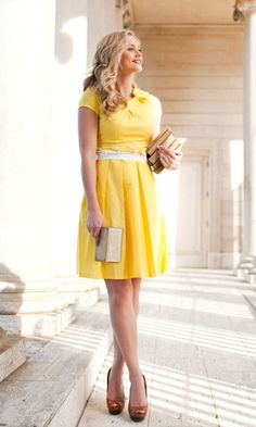 Yellow pleated dress.