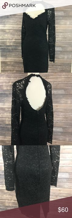 Vintage black lace dress Beautifully crafted black lace dress by Betsy & Adam. Material is nice and thick. Sleeves are made of lace giving an elegant look, a small slit in the very back and button up choker collar. There's no holes or stains, this dress is in excellent vintage condition. Will provide measurements upon request. Betsy & Adam Dresses
