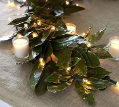 Gilded bay leaf garland wrapped in mini lights on burlap