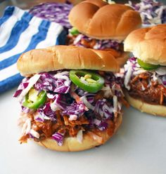 Slow Cooker Crockpot Dr. Pepper Pulled Pork Sandwich topped with homemade sweet creamy coleslaw.