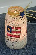 I absolutely love these simple Patriotic Candle Jars...perfect for a centerpiece or use several to light your driveway or sidewalk!