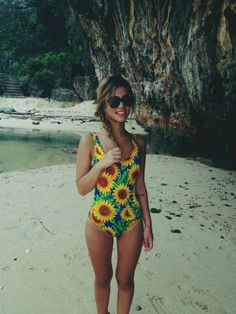 A full piece, cute, summery, old school bathing suit, preferably with sunflowers