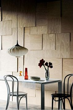 A geometric timber panel wall keeps a space modern while maintaining a natural feel.