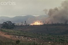 25 Feb 1968, Khe Sahn, Vietnam --- 2/25/1968-Khe Sahn, Vietnam- Napalm bombs and 250-pound snake eye bombs are shown as they go off in support of a pinned down Marine platoon that's been on patrol.  More than half of the patrol was lost due to the heavy fighting. --- Image by © Bettmann/CORBIS