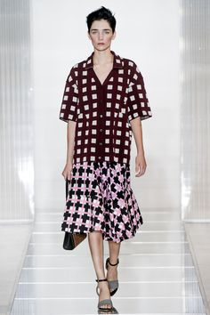 The Marni show for SS 13 was as quirky as ever! But we wouldn't have it any other way! Think mixing prints and 50s housewife with a twist!