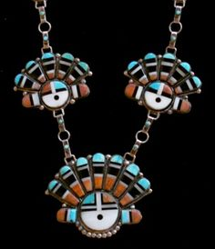 A Zuni Pueblo handmade silver chain necklace with five inlaid stone kachina sun-face pendants, circa 1940's-1950's