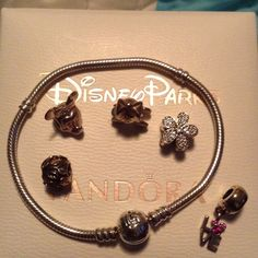 Authentic Disney bracelet Disney bracelet with five charms, three Disney, one with gold, Mickey and carriage are chamilia. Pandora Jewelry Bracelets