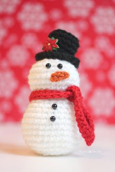 A winter staple to your home décor this cute little snowman would look attractive on any fireplace mantle or windowsill. You could swap the poinsettia out for a snowflake and change his red scarf to an icy blue for the change from Christmas to the remaining winter seasons. FREE PDF pattern found at Repeat Crafter Me: Crochet Snowman Pattern