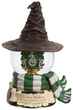This San Francisco Music Box Company musical water globe shows the Slytherin Crest inside the water globe. The Slytherin Sorting Hat sits atop the globe with the green and white scarf wrapped around the bottom of the globe with Harry Potter Musical, Objet Harry Potter, Deco Harry Potter, Theme Harry Potter, Harry Potter Bedroom, Harry Potter Universal, Harry Potter World, Harry Potter Snow Globe, Harry Potter Sorting Hat