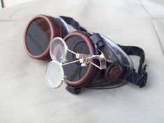 Not even going to try and make them for that price. Cool guns too. Steampunk Goggles Airship Captain Apocalyptic Mad Scientist Special. $29.99, via Etsy.