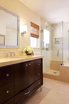 nice combo of tiles in teh shower, like the vanity and framed mirror above. Corry_LaughtonWy_May23_1416871_rev_a