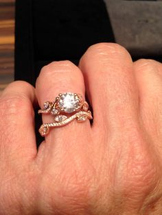 De Beers Adonis Rose solitaire diamond engagement ring in rose gold with matching diamond wedding band.