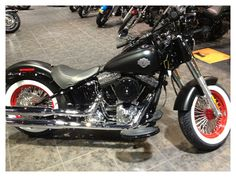 Capitol Harley's customized Softail Slim with retro white walls & red accents. #BestServiceDepartment