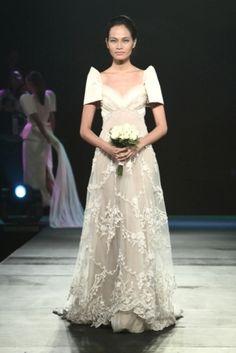 A beautiful Modern Filipinana wedding dress by Jun Escario