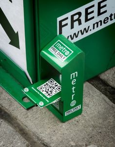 Such a great idea! Metro newspaper promoting their mobile edition w/ tiny newsboxes #QRcode