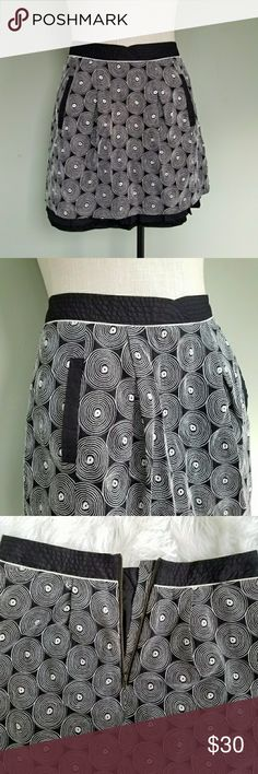 Anthropologie Floreat Whorl and Twirl Skirt Floreat by Anthropologie. Womens 2.  Whorl-And-Twirl Skirt.  Black and white.  Geometric circle swirl pattern.  A-line, flare, skater skirt.  Ruffled layers underneath.  Quilted waistline.  Front pockets.  Zipper back.  Excellent condition! Anthropologie Skirts