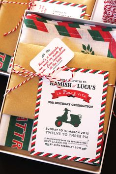 """""""Being a graphic designer, the invitation has always been one of the most exciting expects of planning my kids' party,"""" Li-Ann says. """"I wanted the invitation to double up as a souvenir/ keepsake, yet be something practical so the idea of a 'tea towel recipe' came about. I wanted to keep the colors very traditional — red, green, white with hints of black and kraft. """"The tea towel was then printed in linen fabric and presented to the guest in a box wrapped with kraft paper and a little insert…"""