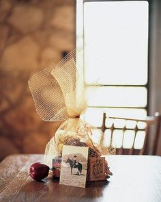 A welcome package with playing cards, Texas-shaped potato chips, piquante sauce, and pecan pralines greeted each of the one hundred guests who spent the weekend at the camp that hosted this Texas soiree.