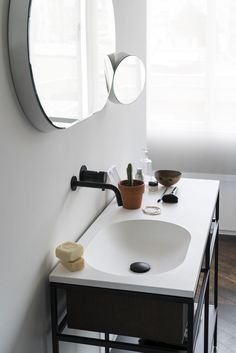 Limited edition Frame System made of Smoked oak and Navona travertineby Norm.Architects and Float & Gravity bathroom mirrors by Samuel Wilkinson, both designed for Ex.t.