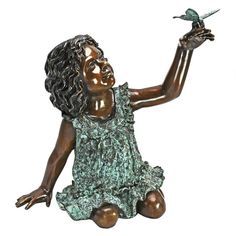 Charming bronze statue of a young girl looking up at the butterfly that landed on her hand. Click image for details.